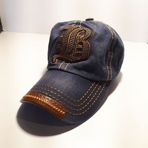 Denim ball hat with faux leather and logo details